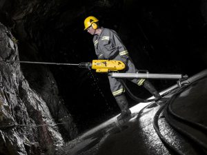 With the Atlas Copco RockDrill 100, RD100 and it´s power unit PP100, a constructor works in a tunnel 450 meters under sea level.